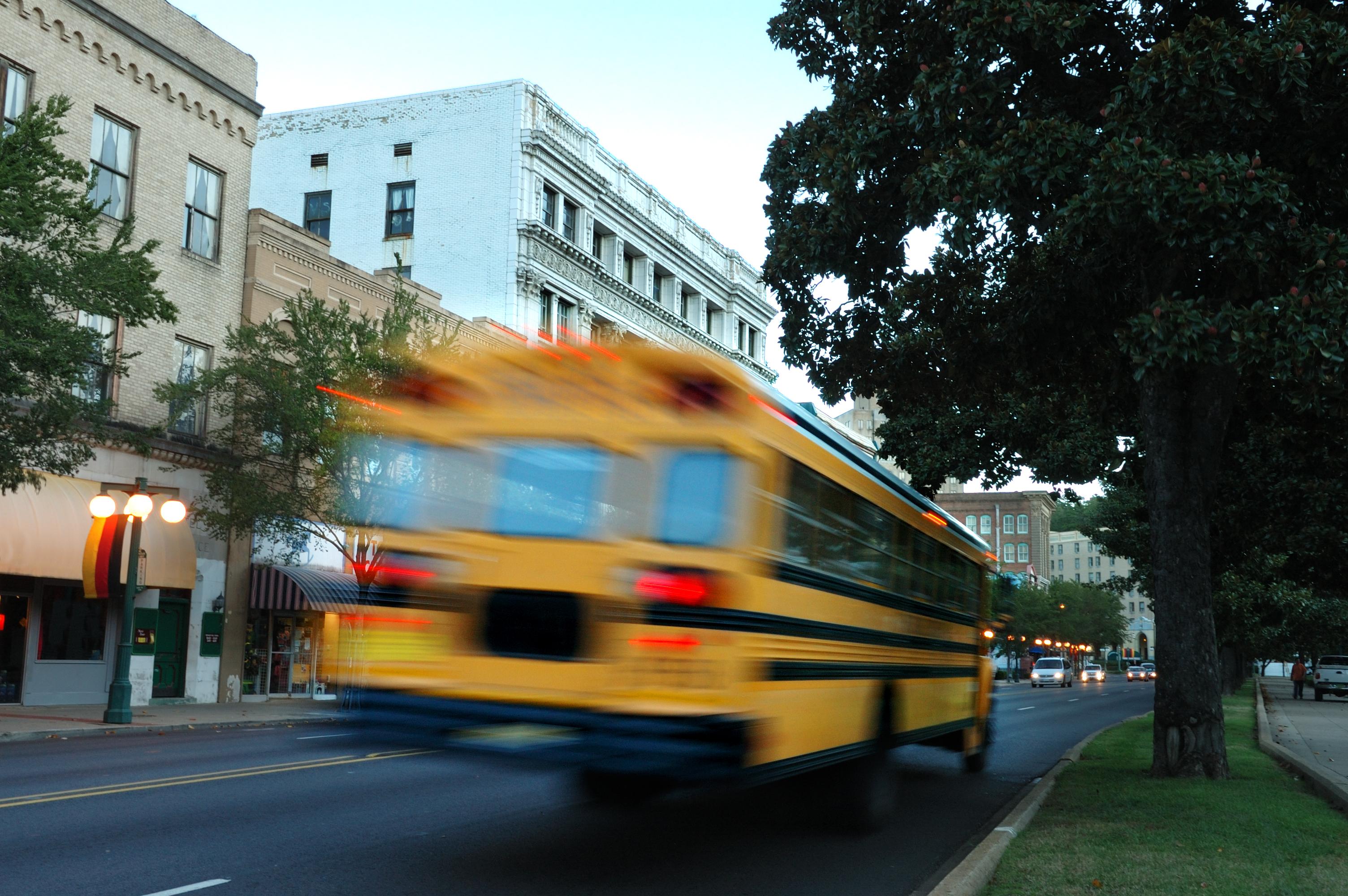 Yellow school bus in motion